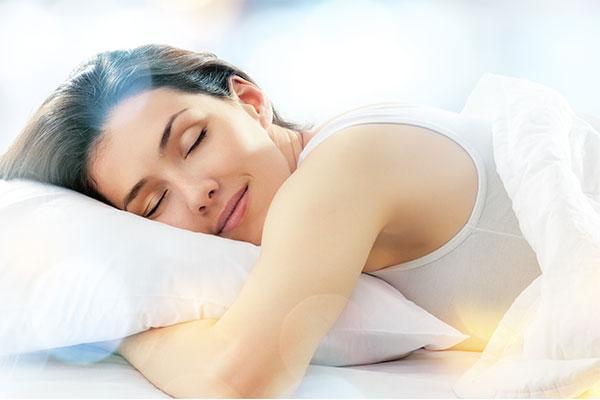 HBOT helped me sleep better. Photo of a happily sleeping woman.