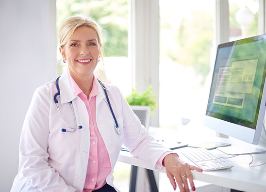 Discuss HBOT with your Physician. Photo of a smiling woman doctor.